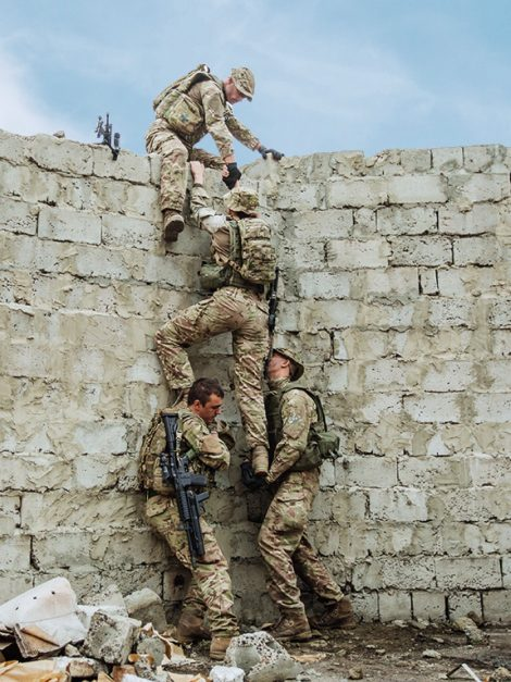 troops climbing over wall